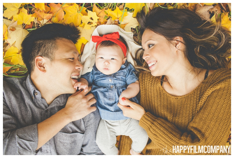 family picture lying in leaves   - Seattle Family Holiday Portraits - the Happy Film Company