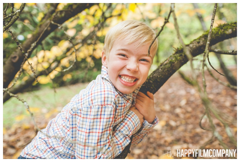 boy with big smile hugging tree  - the Happy Film Company - Seattle family holiday photo shoots - Arboretum