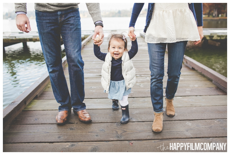 family holding hands walking on dock  - the Happy Film COmpany - Greenlake Park Seattle Family HOliday Photos