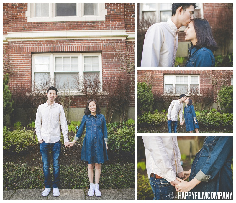 couple holding hands in front of brick building spring portraits  - the Happy Film Company - Seattle Maternity Photography - couples photography