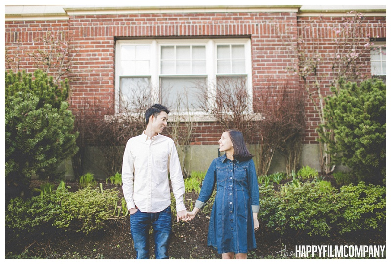 couples photography seattle - holding hands in front of brick building  - the Happy Film Company - Seattle Maternity Photography