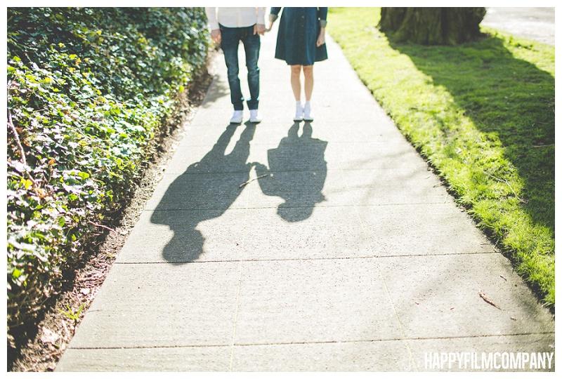 couple walking on sidewalk shadow sunny photo shoot  - the Happy Film Company - Seattle Maternity Photography