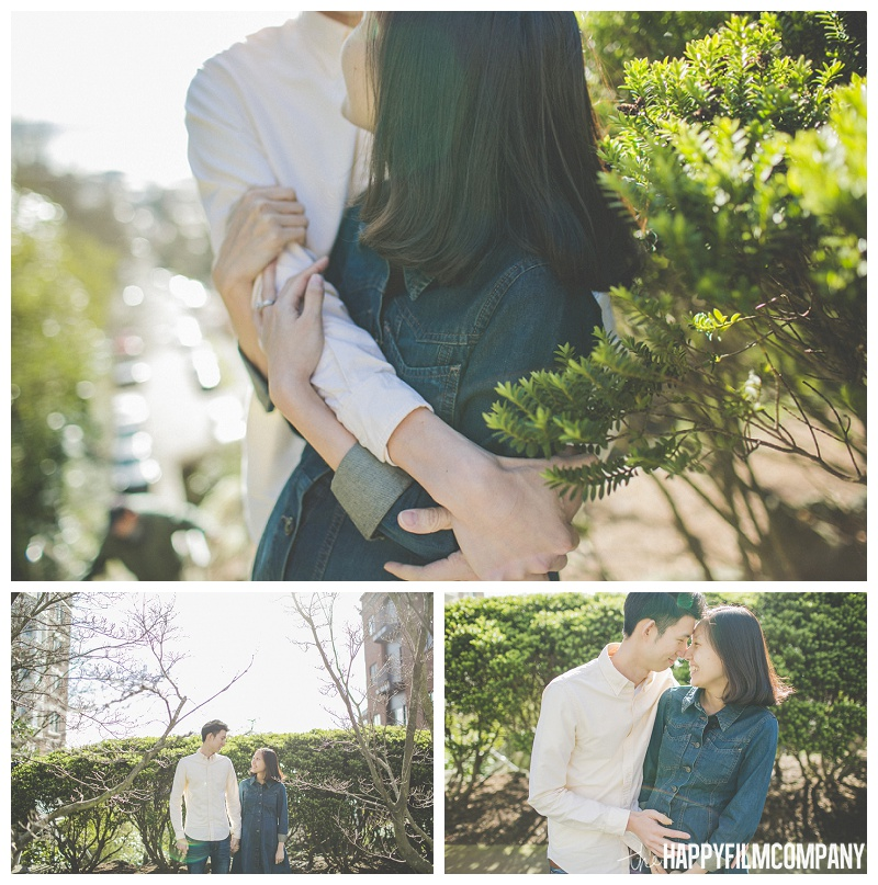 couple cuddling in bush sunshine spring portraits  - the Happy Film Company - Seattle Maternity Photography