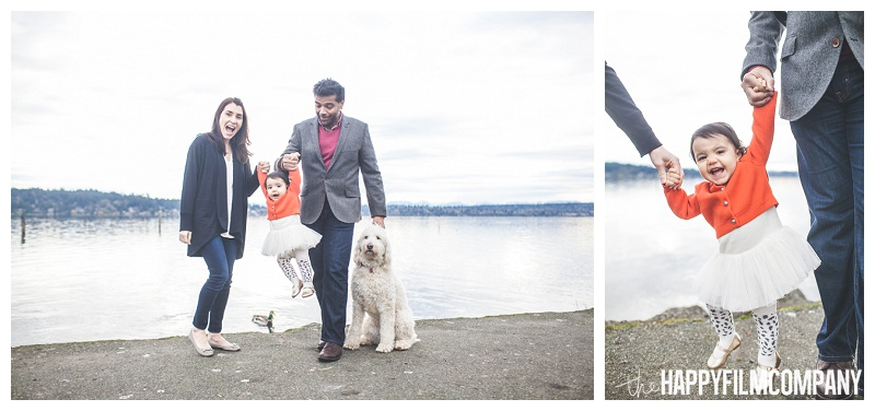 little girl in red sweater with parents and white dog at matthews beach  - the Happy Film Company - Seattle PEPS Group Photo Shoot