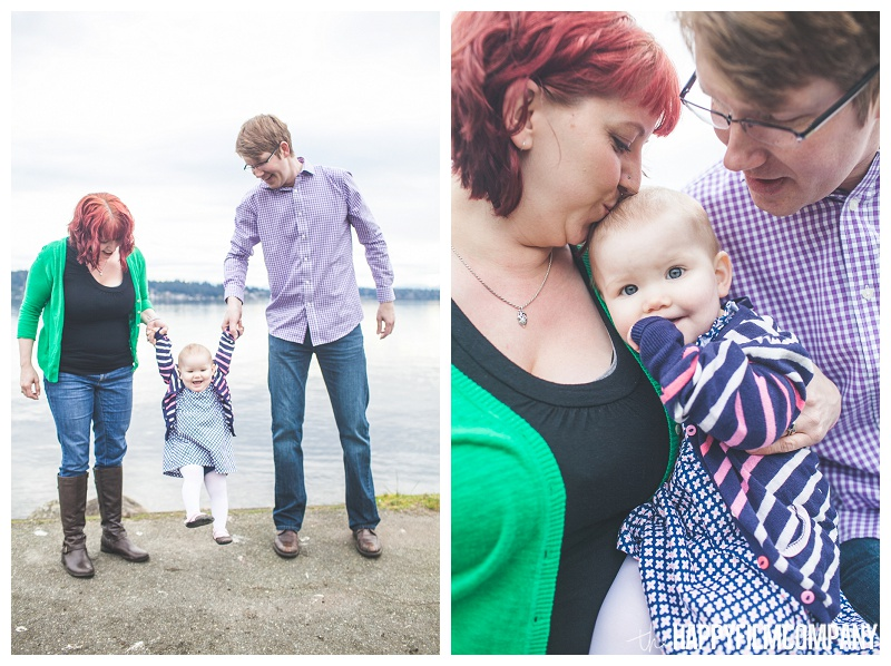 holding baby in the air and cuddling with parents at matthews beach  - the Happy Film Company - Seattle PEPS Group Photo Shoot