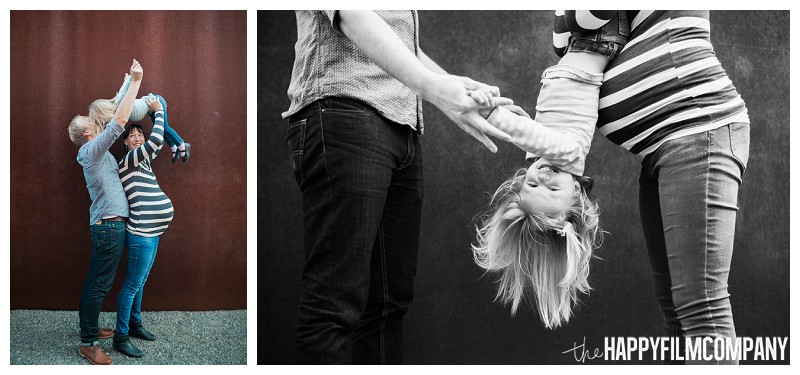 Mom and dad playing with their daughter  - the Happy Film Company - Seattle Family Photography