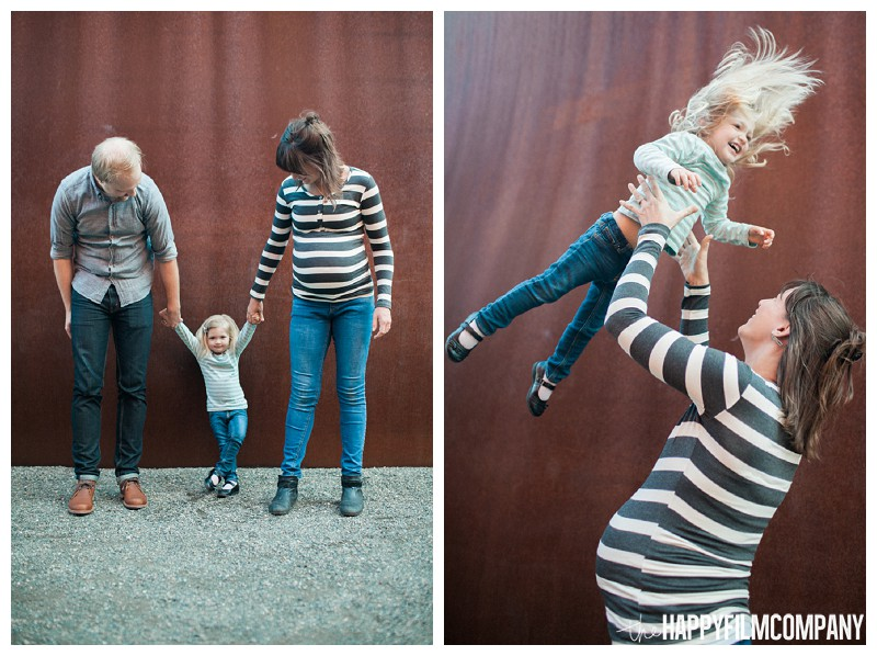 Family of three playing together with little guy on the belly - the Happy Film Company - Seattle Family Photography