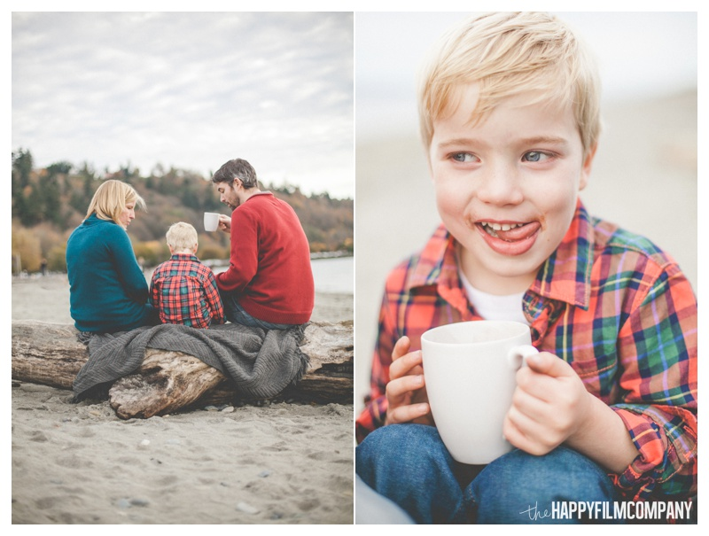 Family of three - At the beach - sitting on drift wood - boy drinking hot chocolate - the Happy Film Company - Seattle Family Photos