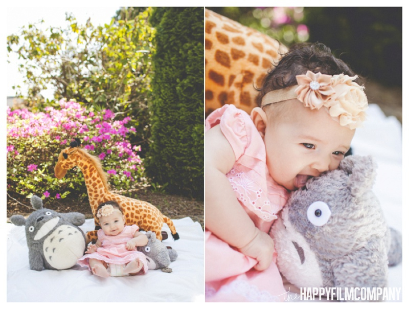 Baby girl with stuffed animals - the Happy Film Company - Seattle Family Photos
