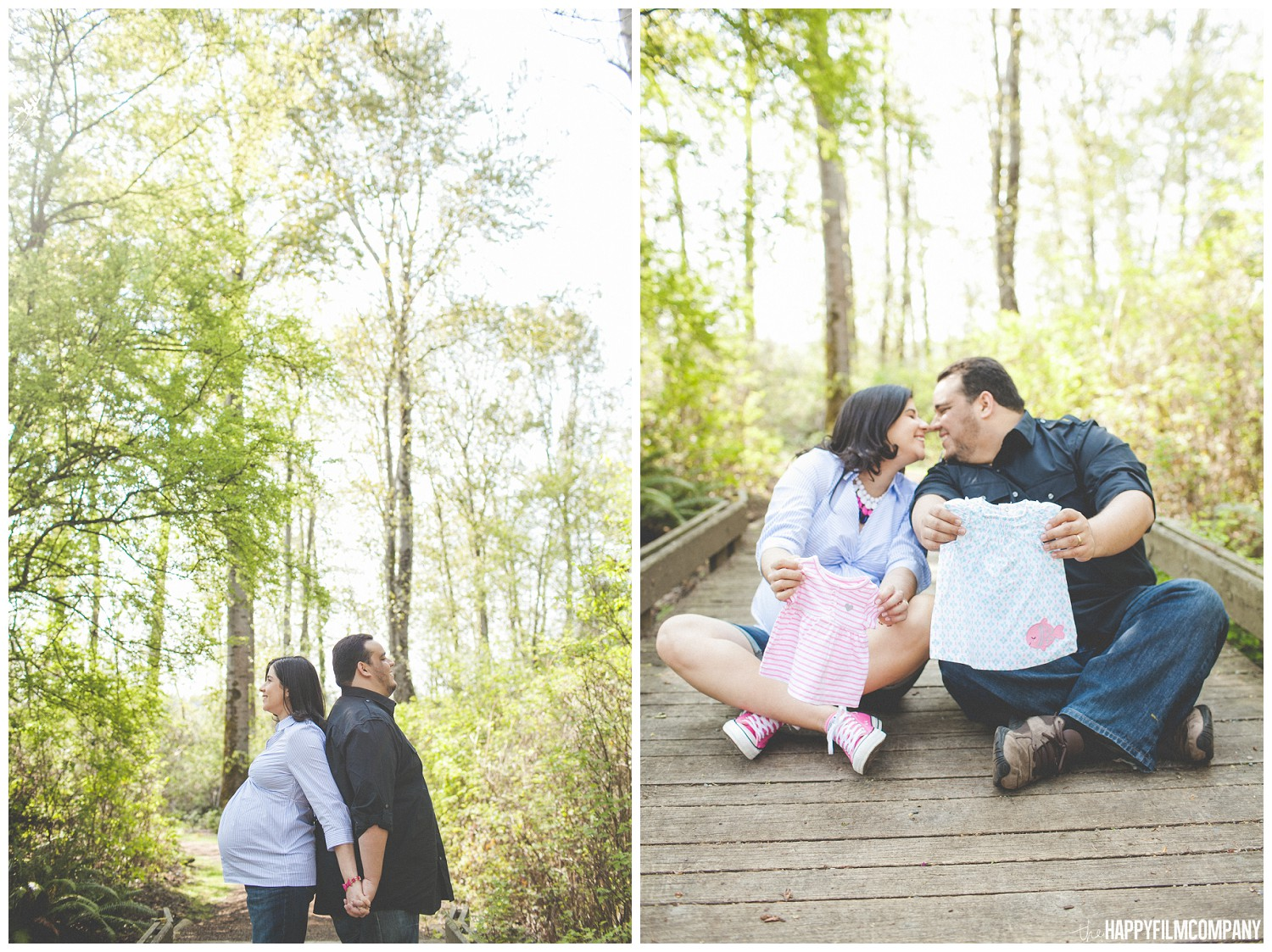 Couple kissing while holding baby's clothes -  the Happy Film Company - Seattle Family Photos