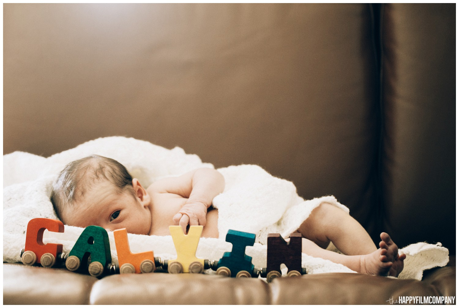 Newborn baby with wooden letter name trains - the Happy film Company - Seattle family photos