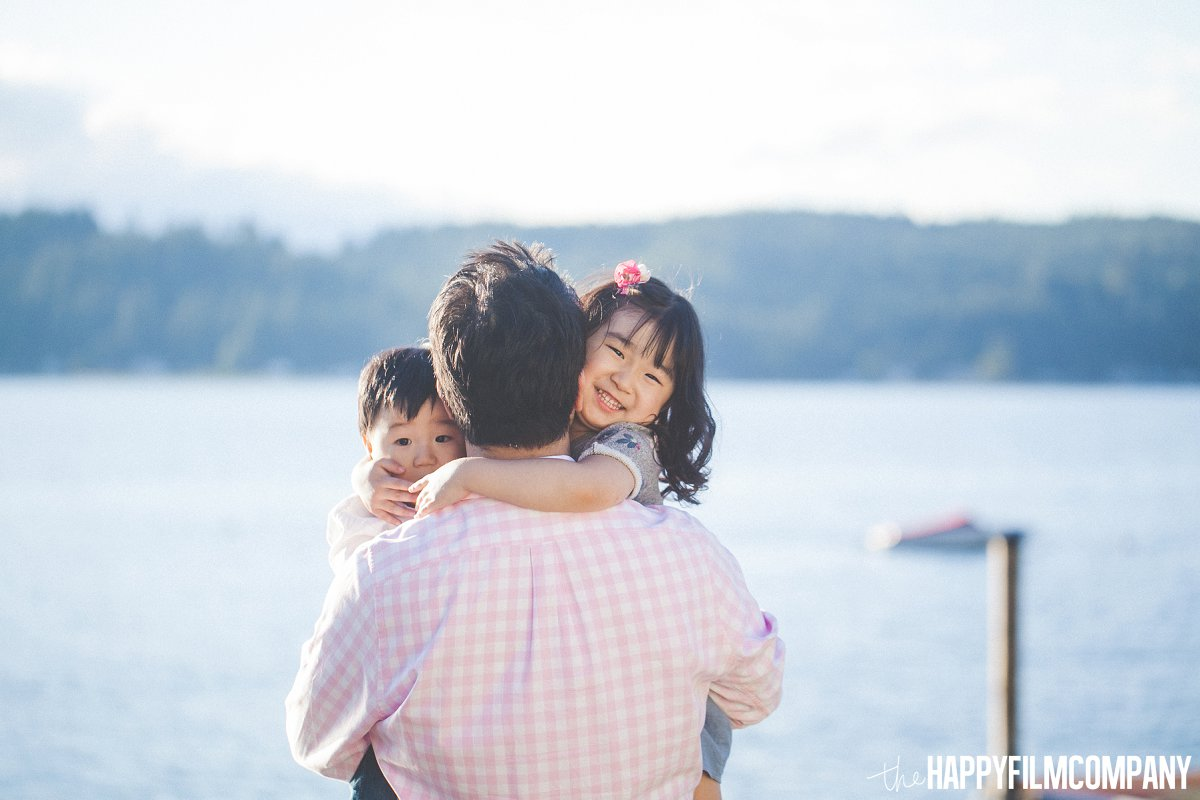 Dad carrying two cute kids - the Happy Film Company - Seattle Family Photos
