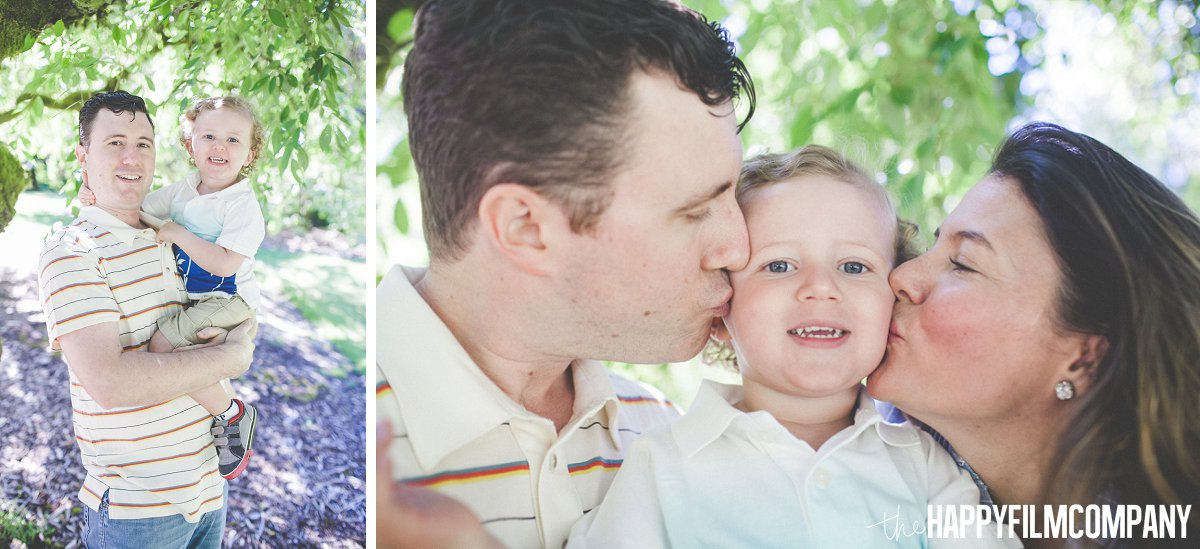Mom and Dad kissing their son -  the Happy Film Company - Seattle Family Photos