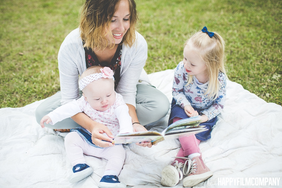 Mom reading books with her little girls - the Happy Film Company - Seattle Family Photos