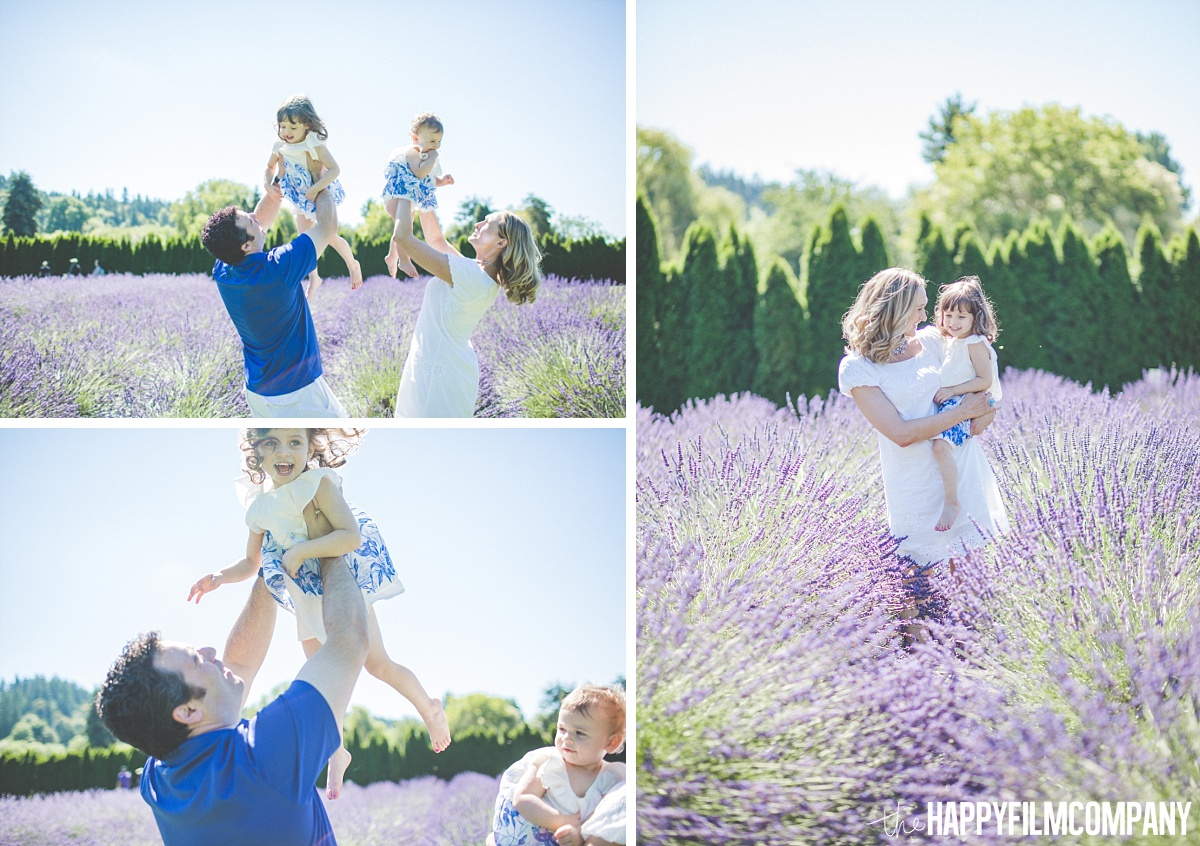 Mom and Dad lifting kids in the Lavender fields - the Happy Film Company - Seattle Mini Family Photo Shoots