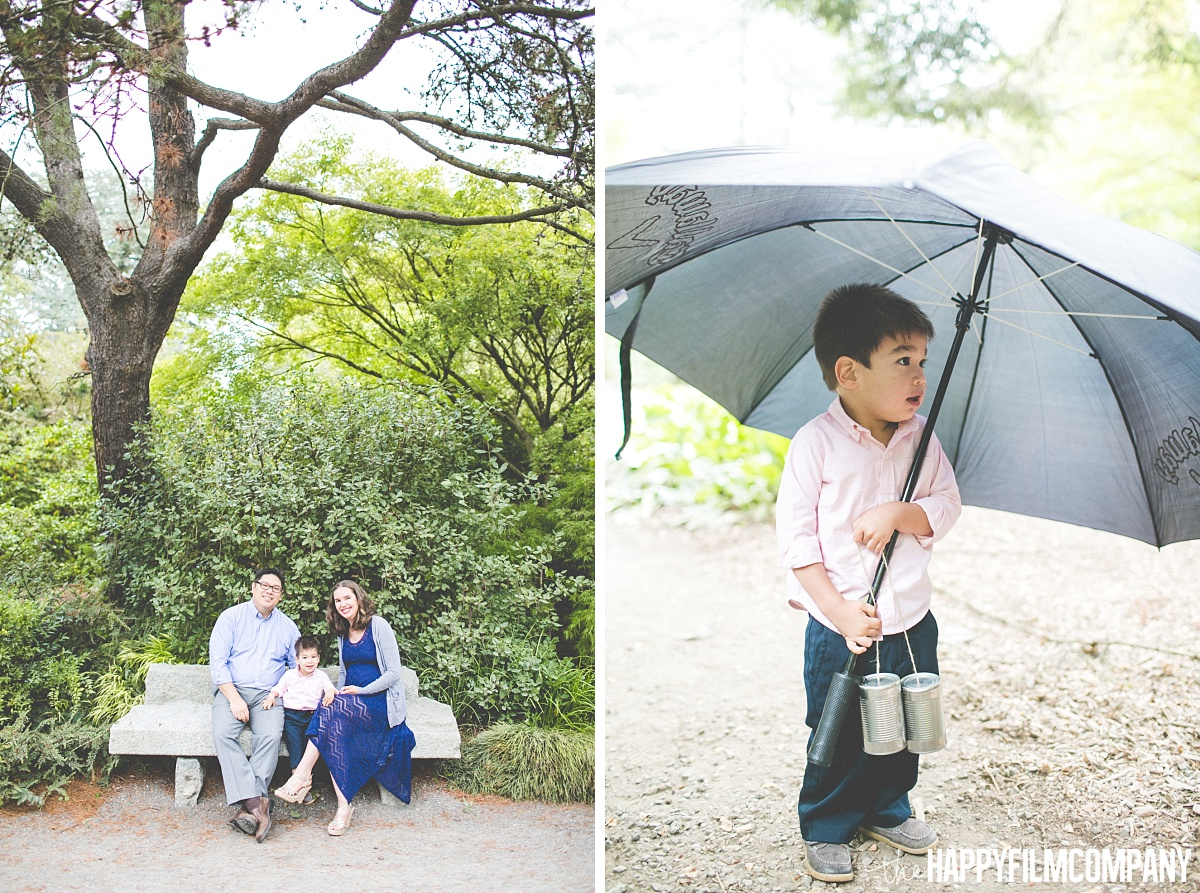 Family portrait in the forest - Little boy holding a big grey umbrella - the Happy Film Company- Seattle Family Photos