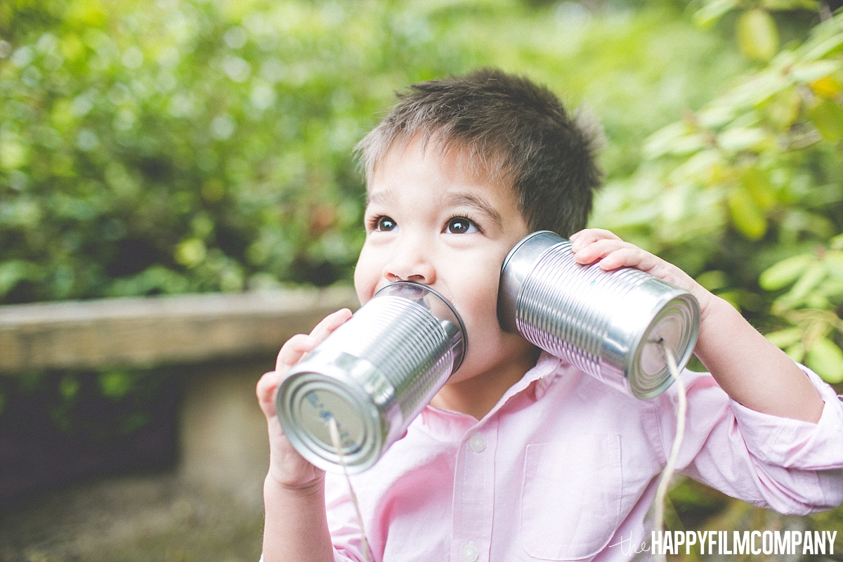 Little boy holding a can telephone - the Happy Film Company- Seattle Family Photos
