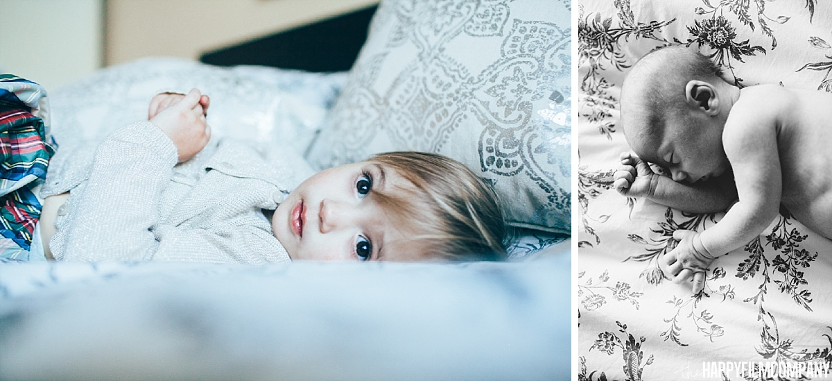 Little girl and newborn baby lying in bed -  Happy Film Company - Seattle Family Photos