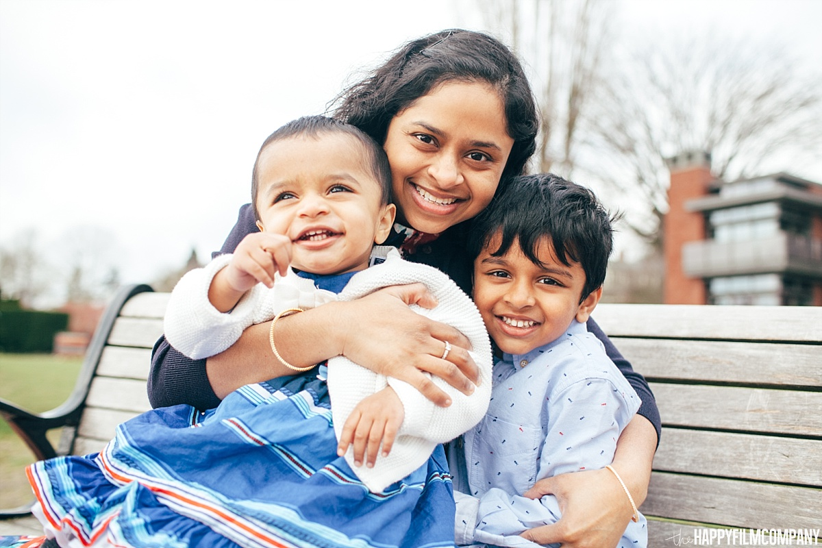 Mom sitting at the bench with her 2 son - the Happy Film Company - Seattle Family Photos