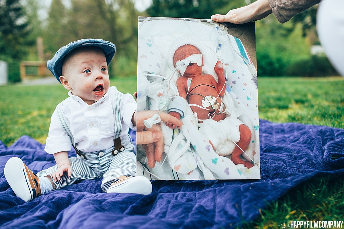 Little boy holding his baby photo -the Happy Film Company - Seattle Family Photos