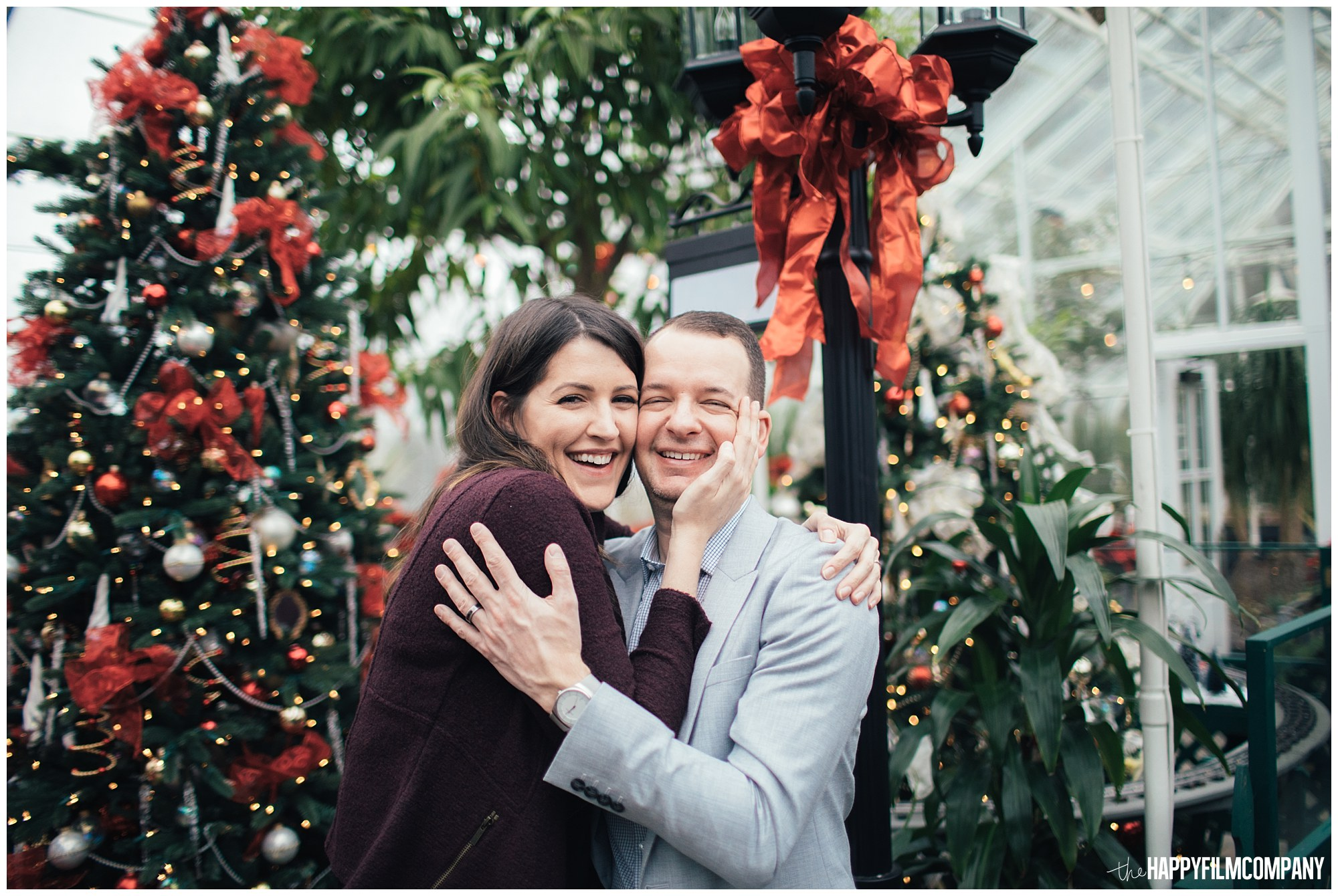 the Happy Film Company - Seattle Family Photos - Volunteer Park Conservatory - couples portraits holiday decorations background