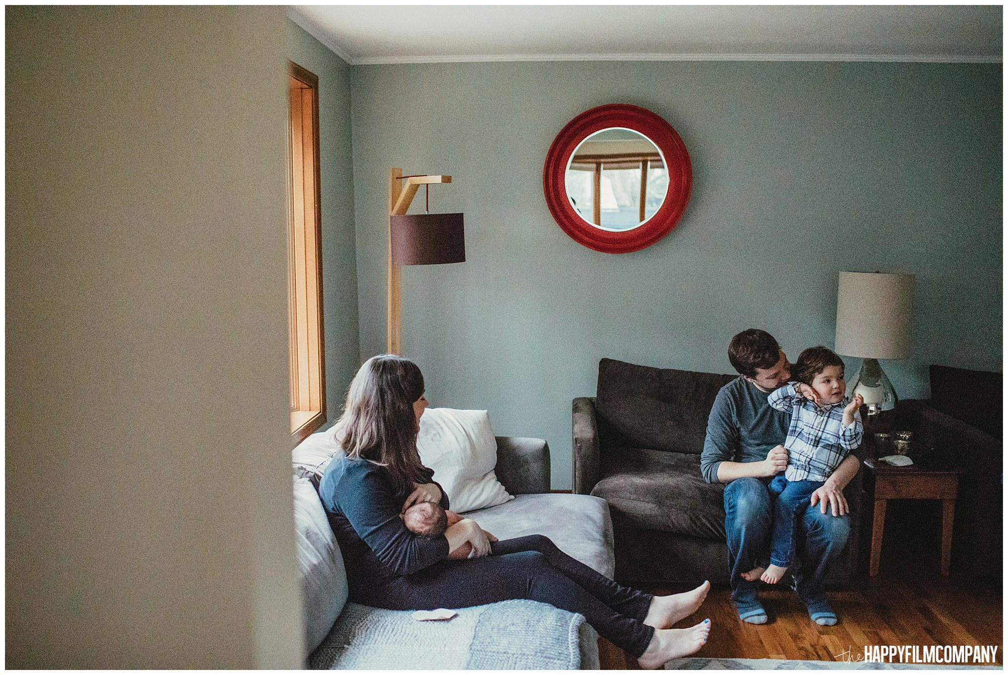 the Happy Film Company - Seattle Newborn Photographer - family in living room - at home portraits