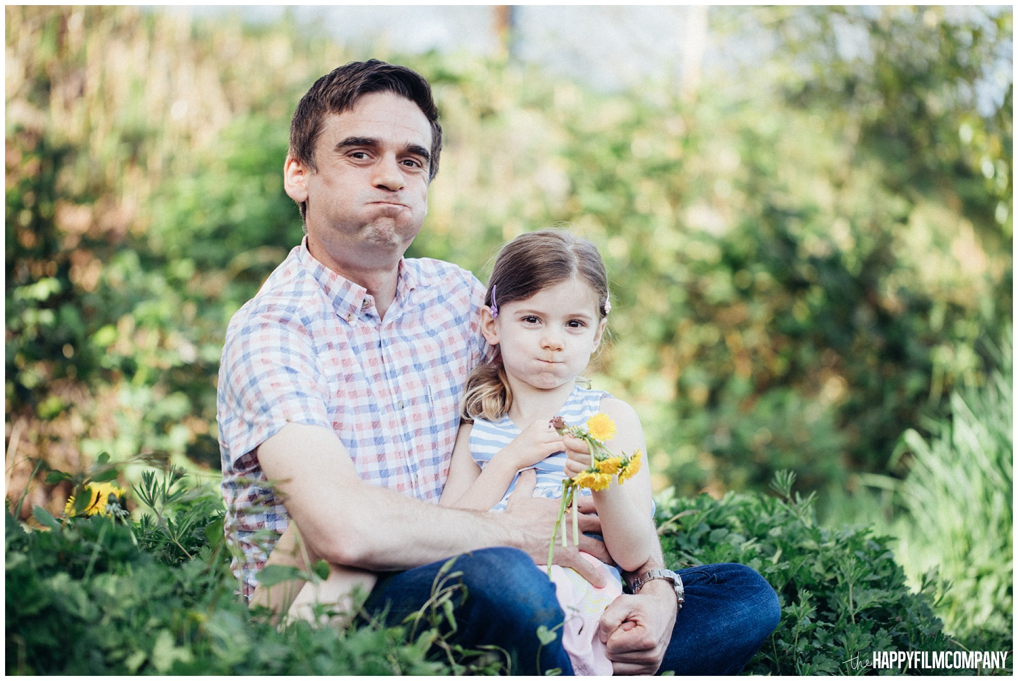 the Happy Film Company - Seattle Family Photography - Father Daughter Portraits - Redmond Grass Field Dandelion silly faces