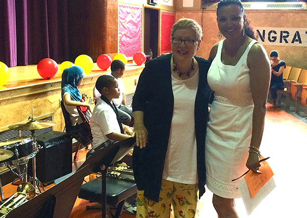 DK Holland and Principal Lena Barbera prepare for the PS 20 5th grade commencement