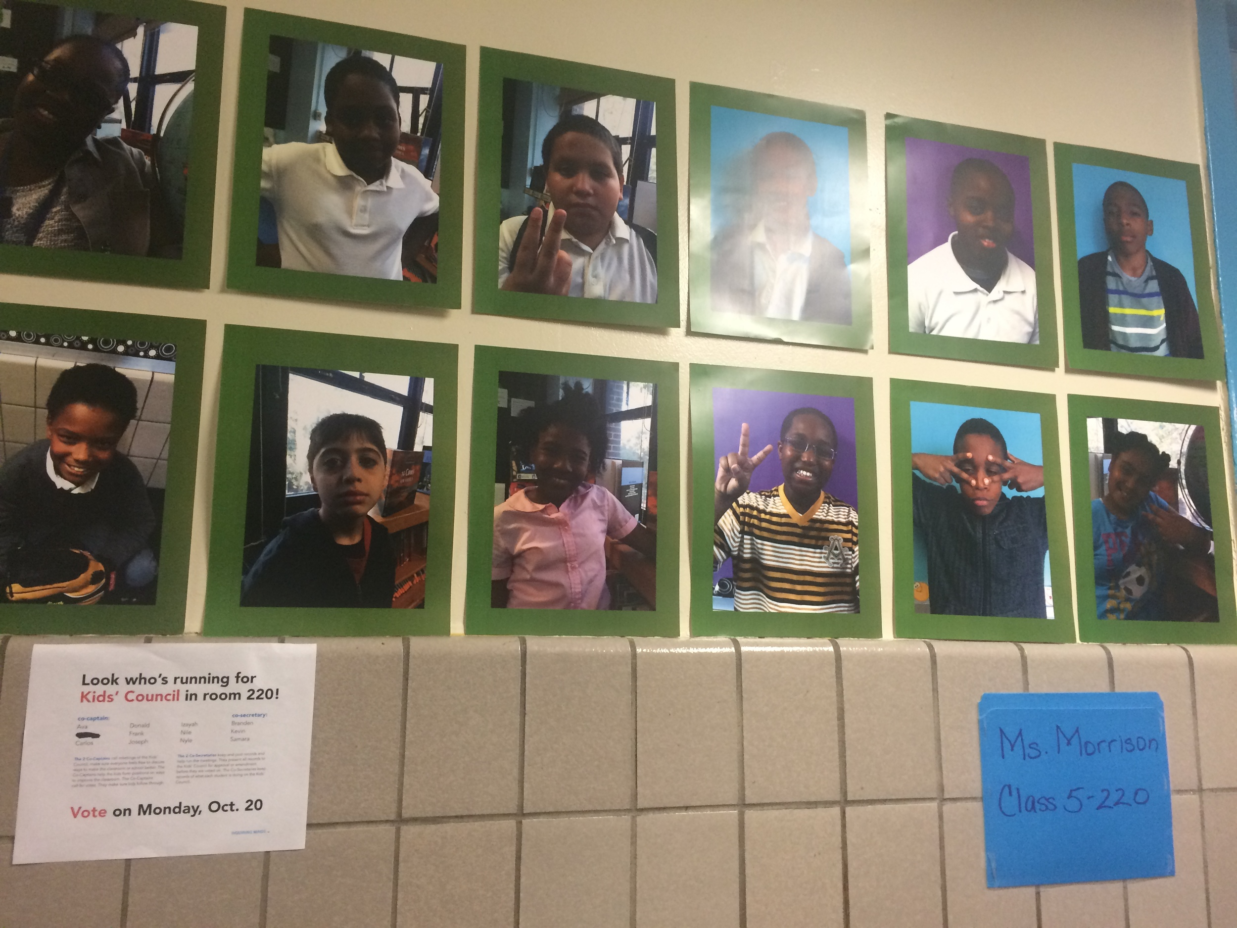 The posting of Kids' Council candidates, in the hall, right outside room 220.
