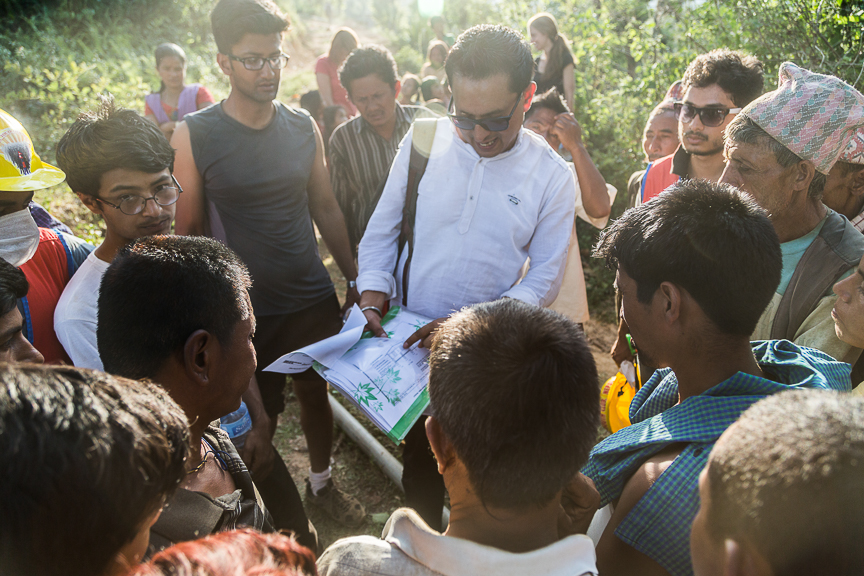 Mr. Yuvraj Sharma explaining the construction plans with the villagers of Sipapokhare.