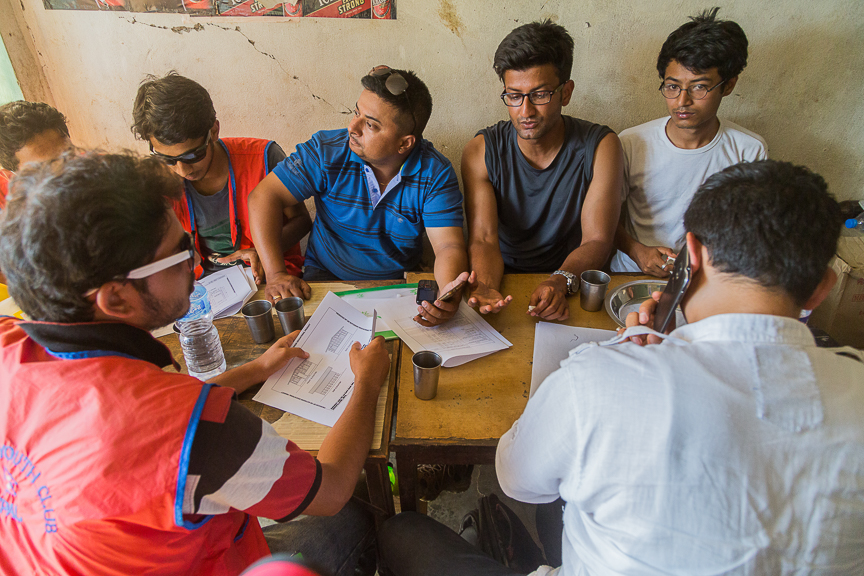 Mr. Kirti Thapa and Dr. Dikshanta Prasai planning the construction activities in a local restaurant with the other volunteers.