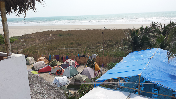 I slept in a tent not far from the shore on the beach for about a month. I will never forget the ocean breeze and waves putting me to sleep every night.