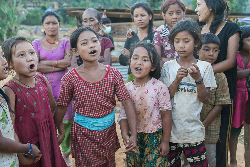 Local girls from the village singing for us during down time.
