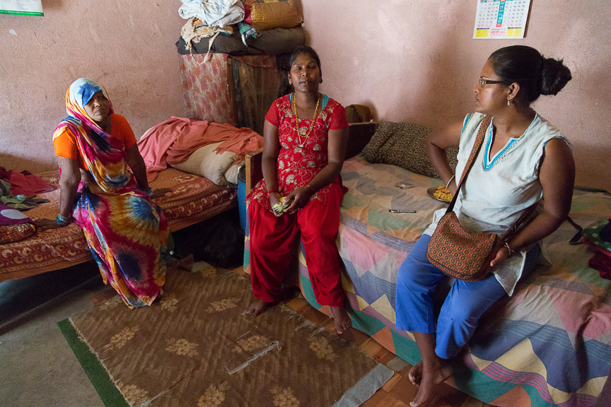 Succi talking to a couple of women in Kathmandu about their issues and needs related to earthquake relief.