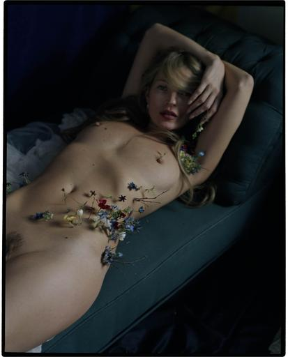 Kate Moss sprouting wild flowers. 2012. Tim Walker.