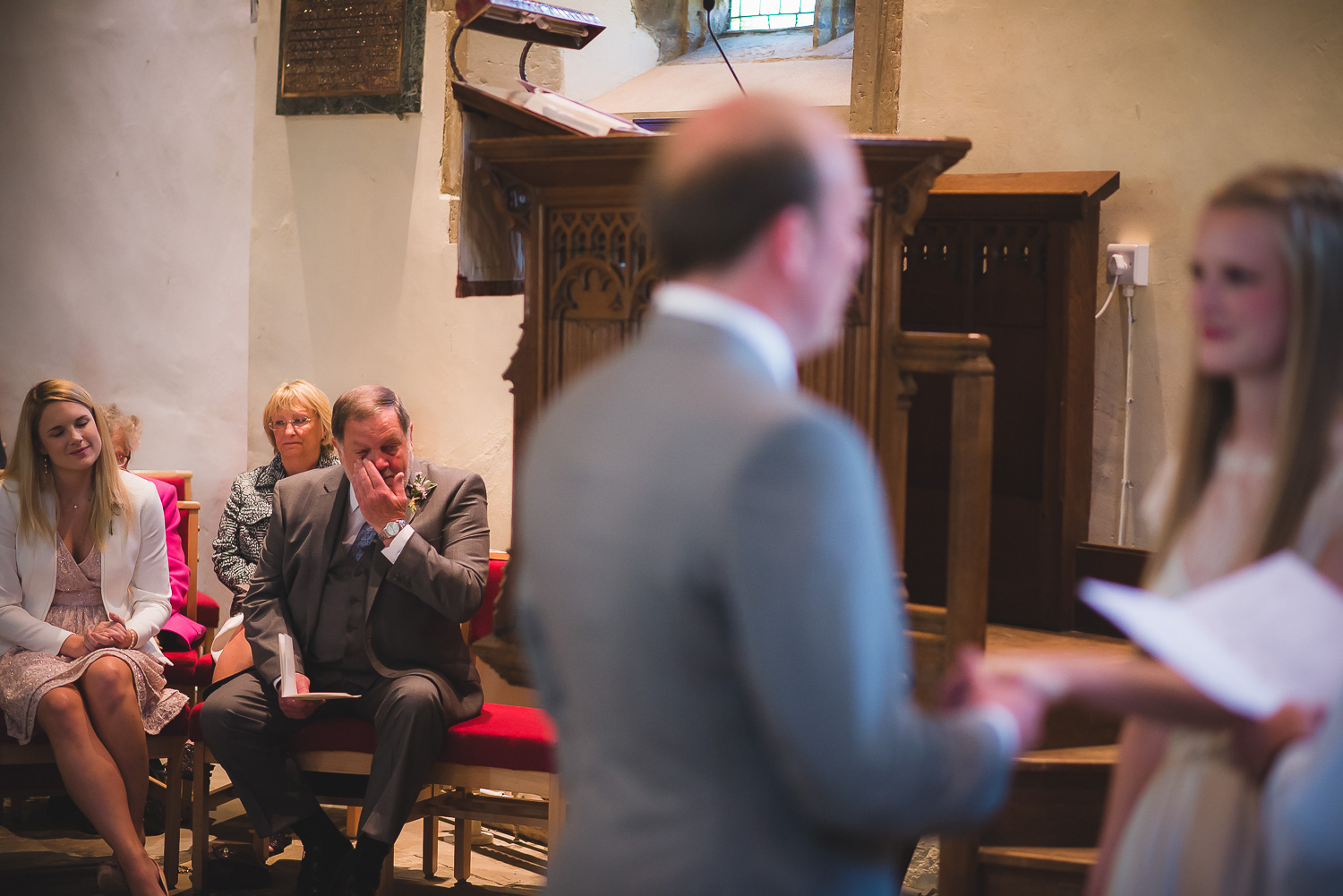 father of the bride crying at wedding ceremony in a church in sussex uk