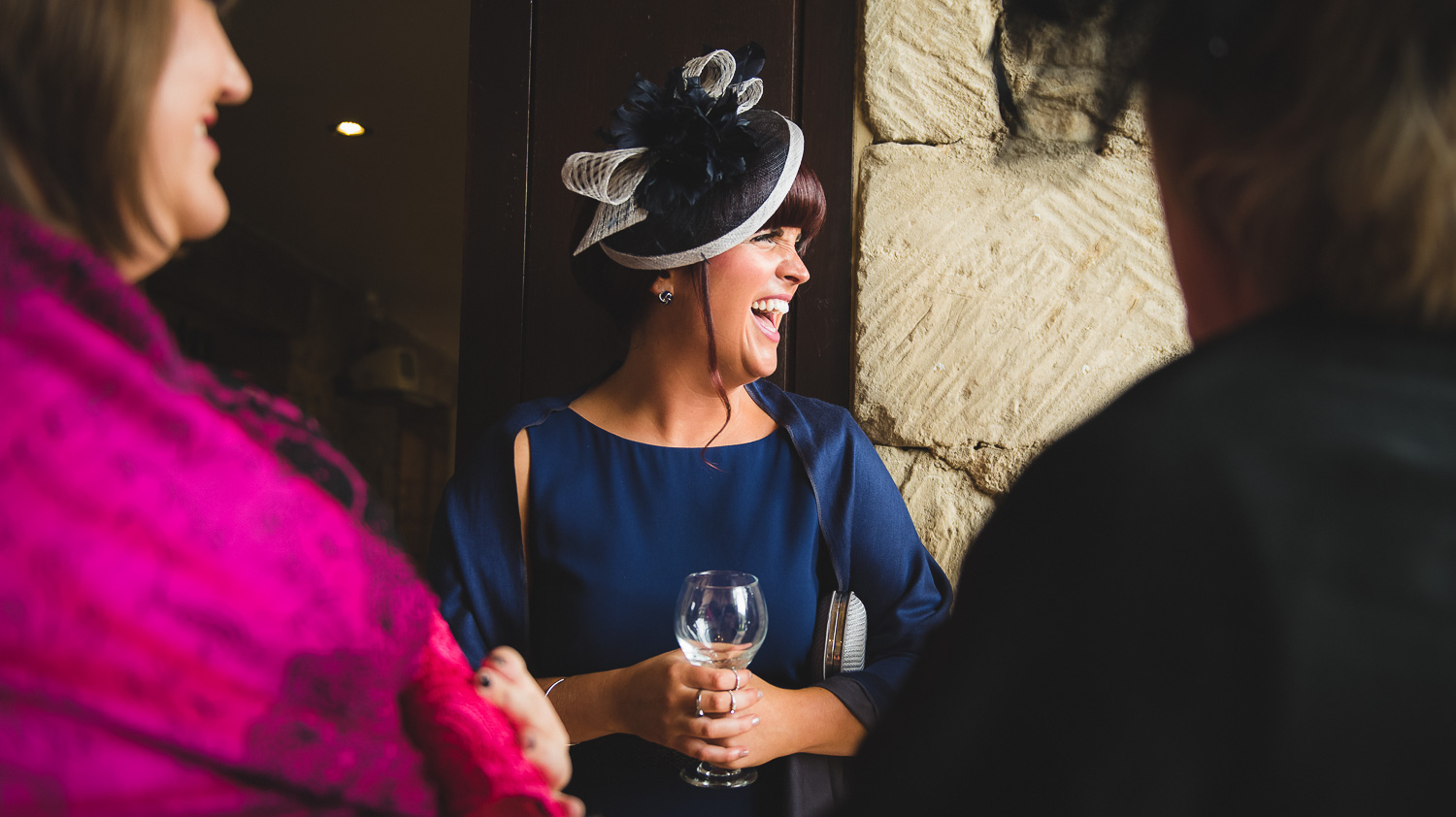 wedding hat ideas and guests having fun at wedding venue in cotswolds