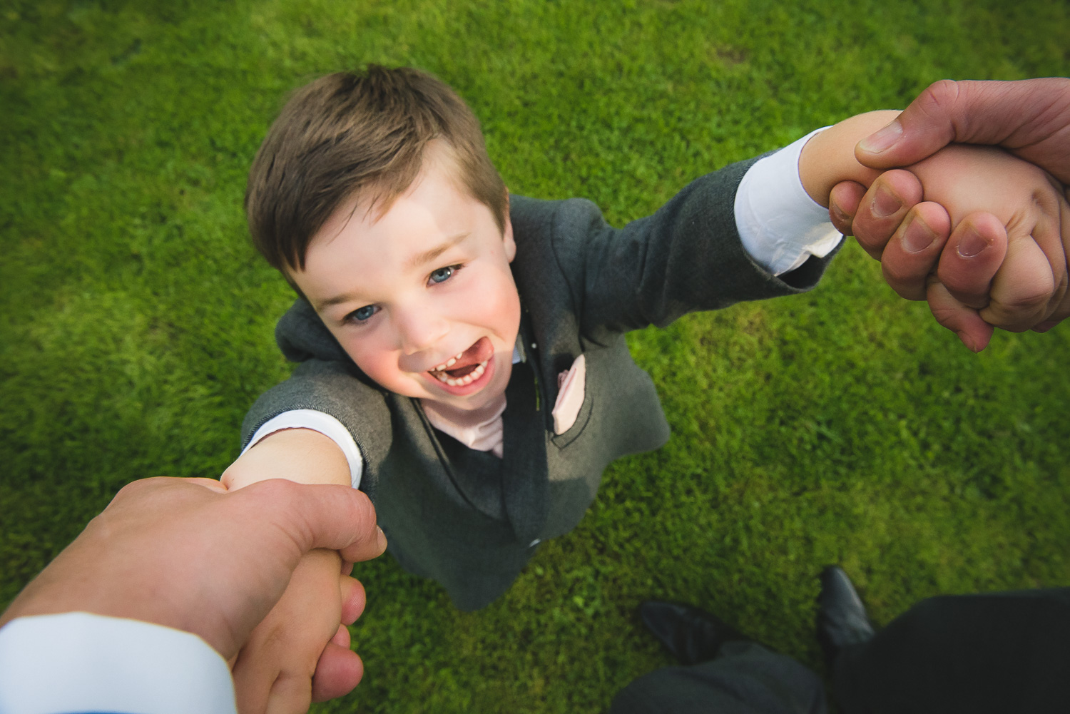 creative wedding photograph of child at wedding playing games