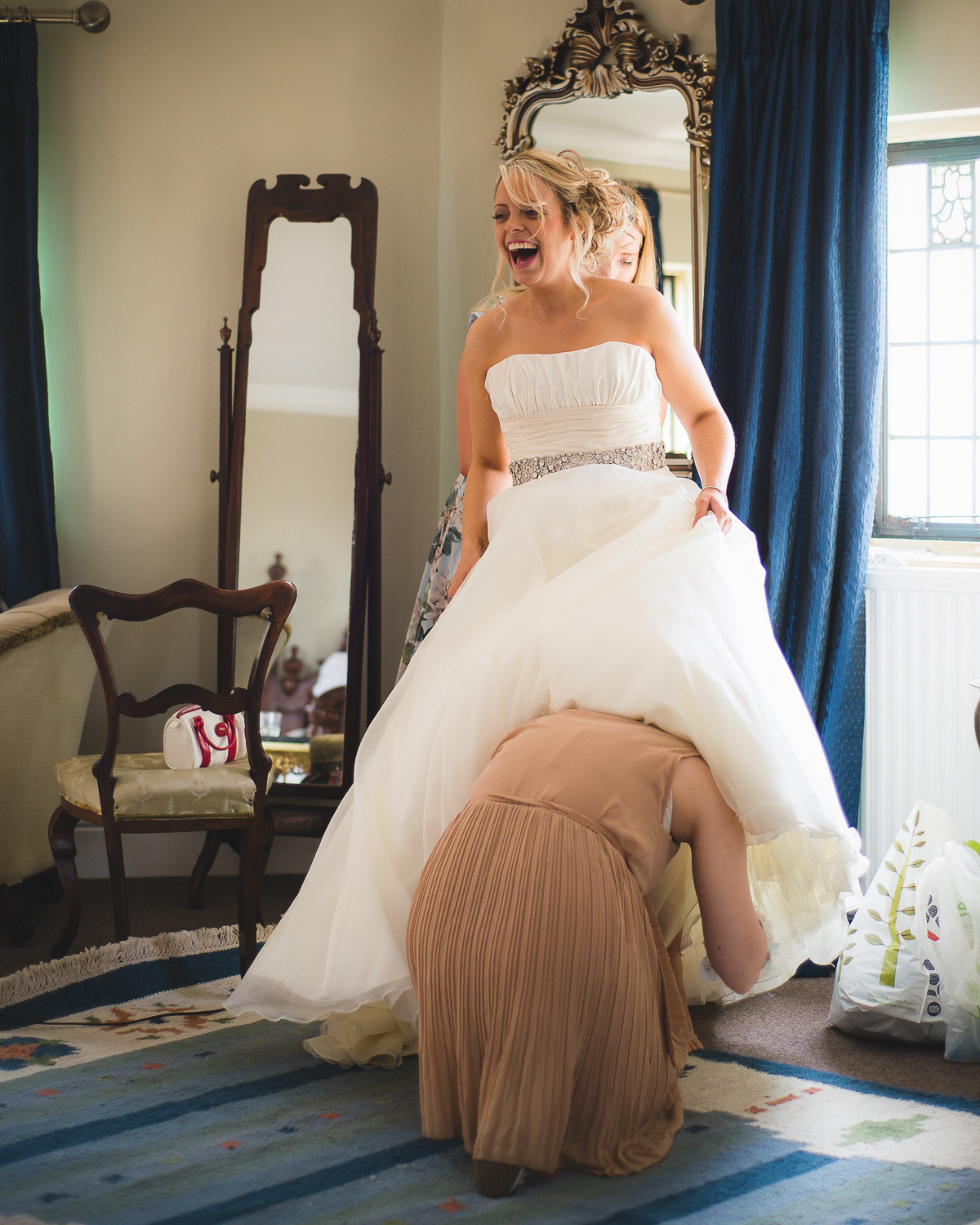 funny picture of bride getting dressed at walton castle clevedon