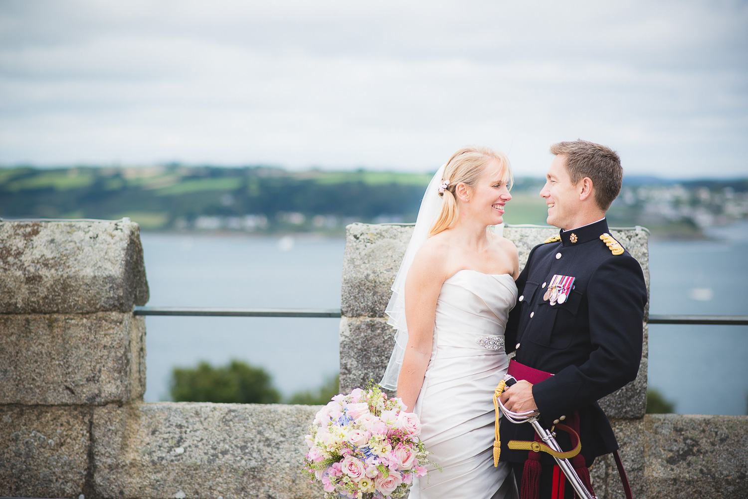 lovely natural photo of army groom and bride at wedding on a castle