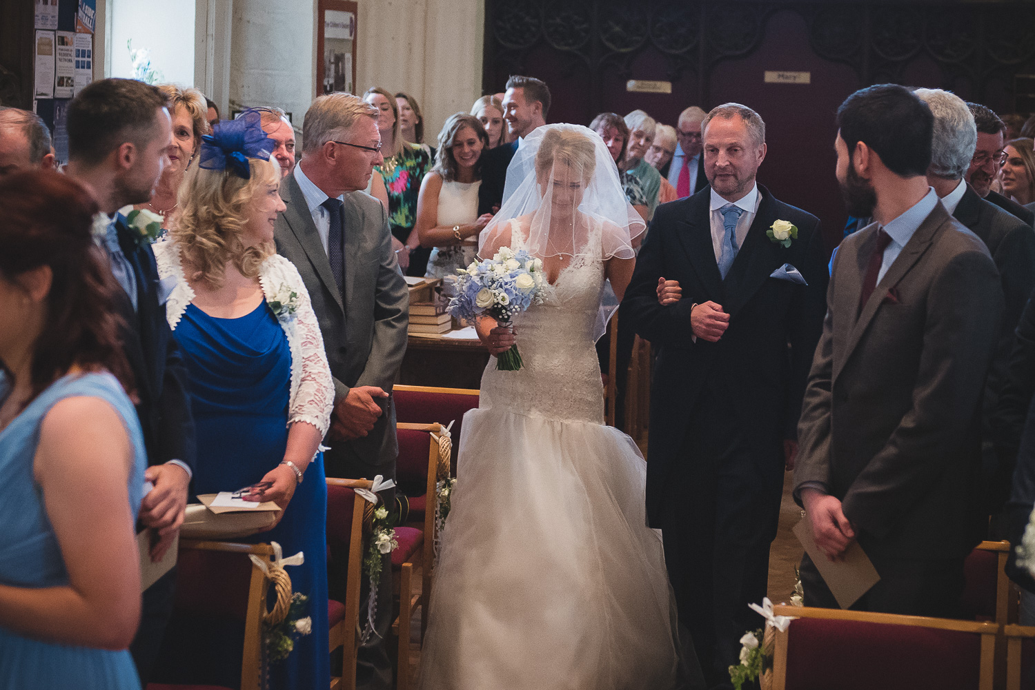 emotional bride walking down st peter's chruch in portishead
