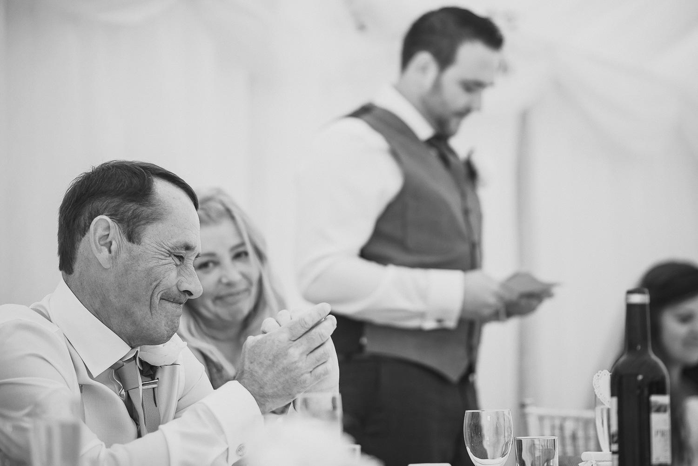 emotional speeches at wedding in black in white