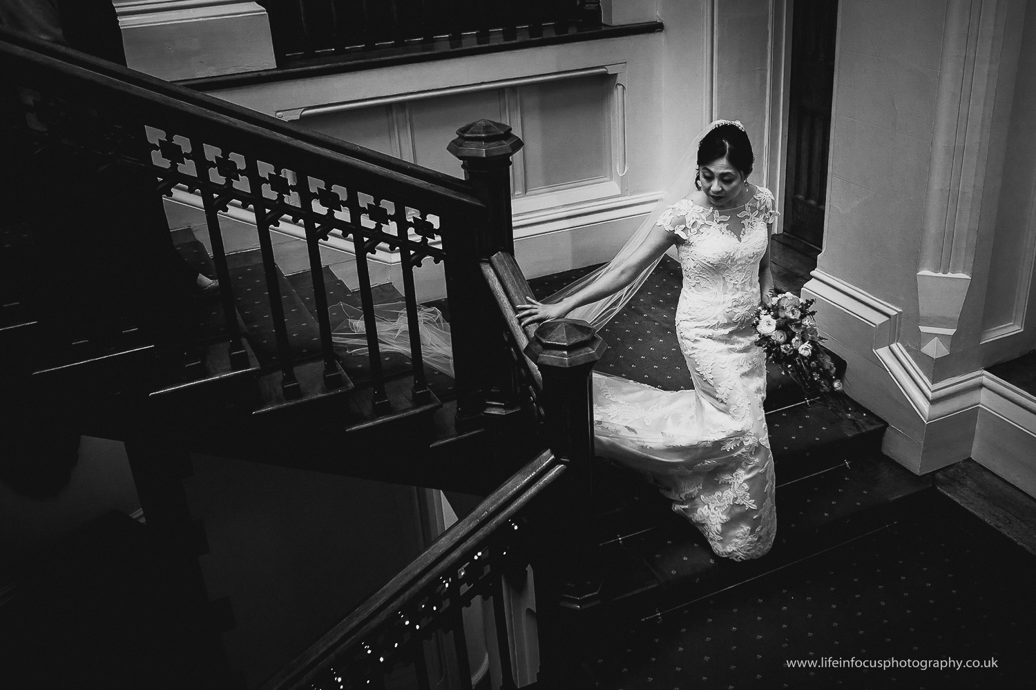 bride walking down stairs at st audries park wedding venue