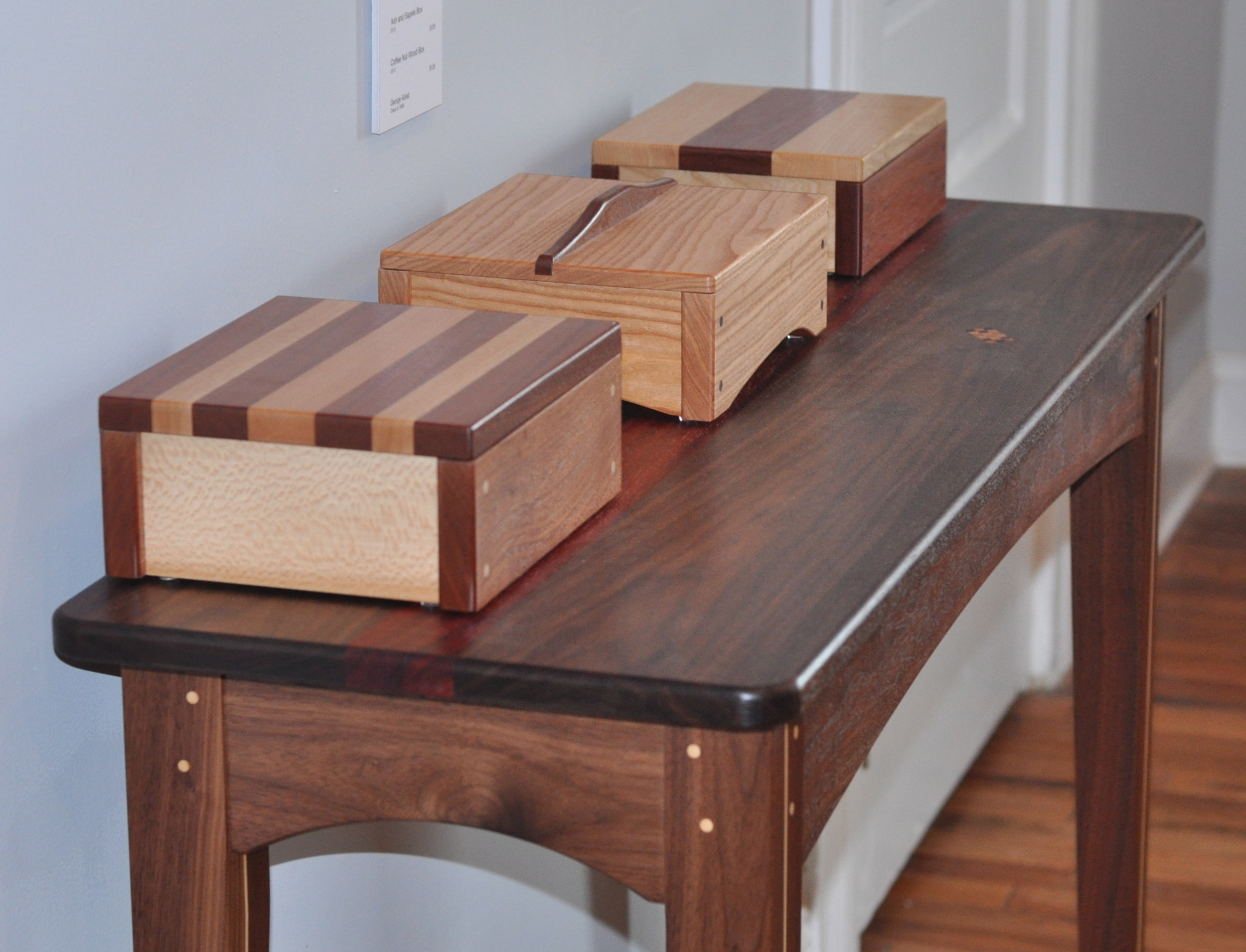 Keepsake Box   Quarter sawn Sycamore and Sapele, 2012    Ash and Sapele Box, 2012    Coffe Nut Wood Box, 2012  Entryway Table Walnut, Maple, African Padouk, 2013  George Abiad Class of 1989