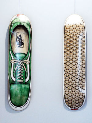 "Two new exhibits at Park Place Arts. This is ""Old School Walk"" and ""Old School Waffle"" by Jeremy Selzer using mixed media on skateboard decks."