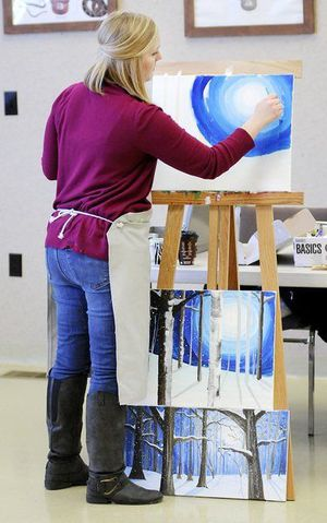Melody Carr leads her students step by step through the painting of a winter landscape at Mounds State Park on Saturday. The class was so popular that a second was added.