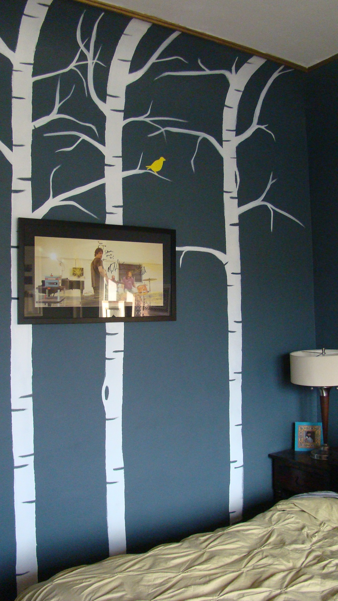 I hand painted these birch trees up the wall to create more interest and it's less commitment than wallpaper. It really brings your eyes up to our amazing ceilings.