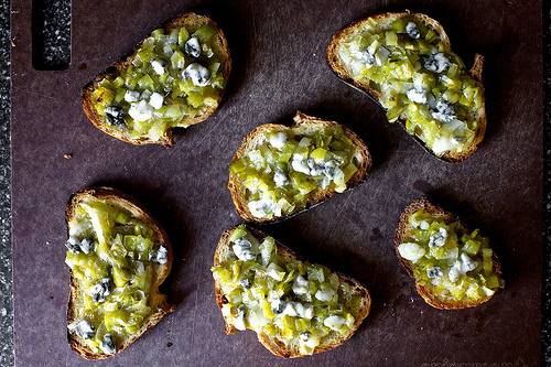 Leek toasts with blue cheese.   http://smittenkitchen.com/blog/2011/05/leeks-toasts-with-blue-cheese/