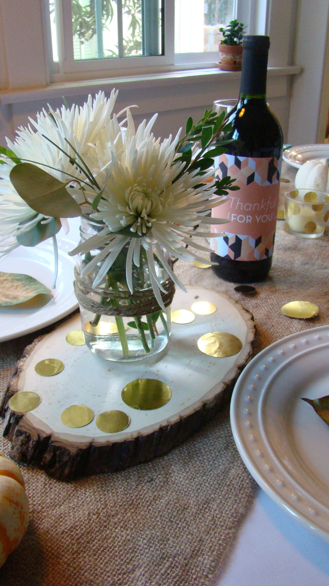 Simple floral arrangement.  Alex printed labels and covered the wine bottles, clever!