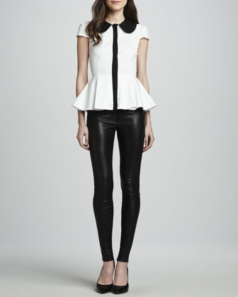 Alice + Olivia leather leggings  There are a ton of really inexpensive leather look leggings this season.  Just opt for something with low sheen and a velvety feel and you'll fool them!
